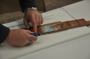Using a Sharp Utility Knife to Trim the Edge of Leather Lining on a Custom Strap after Glue and Sitched Assembly