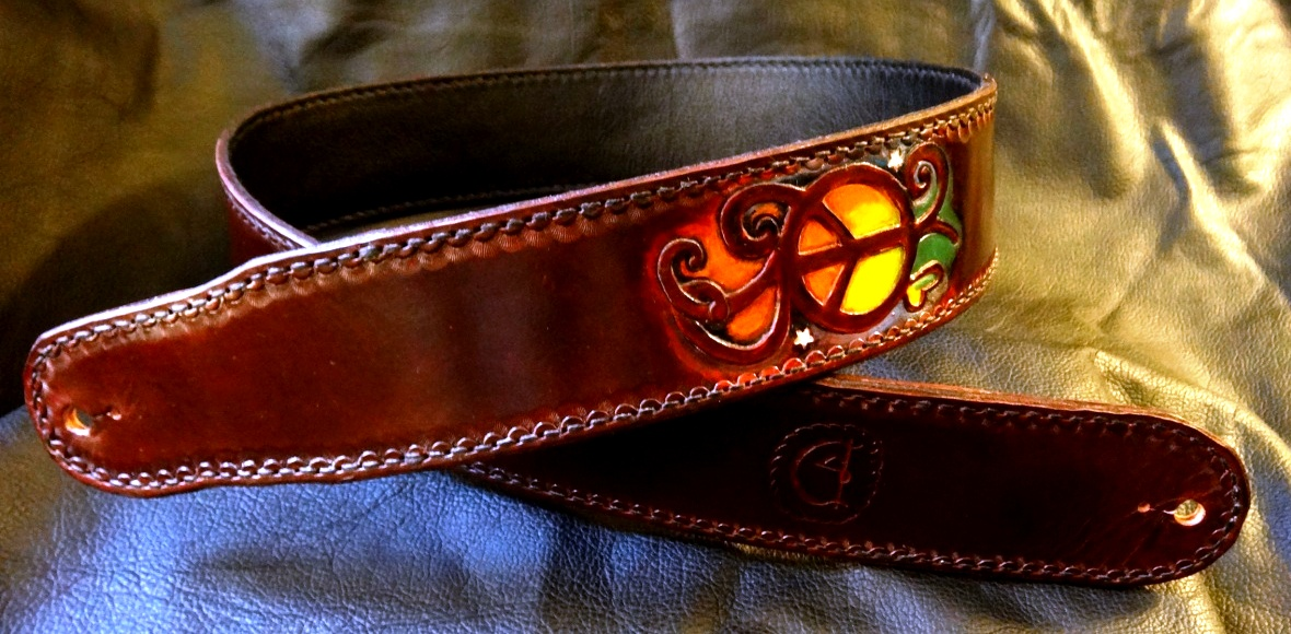 CT Artisan Strap with custom upgrades finished in artistic details on mahogany background.